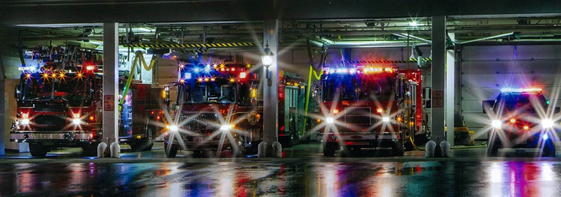 Fire Engines at Night with Lights on