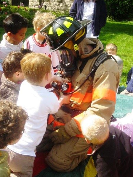 Firefighter Surrounded by Kids