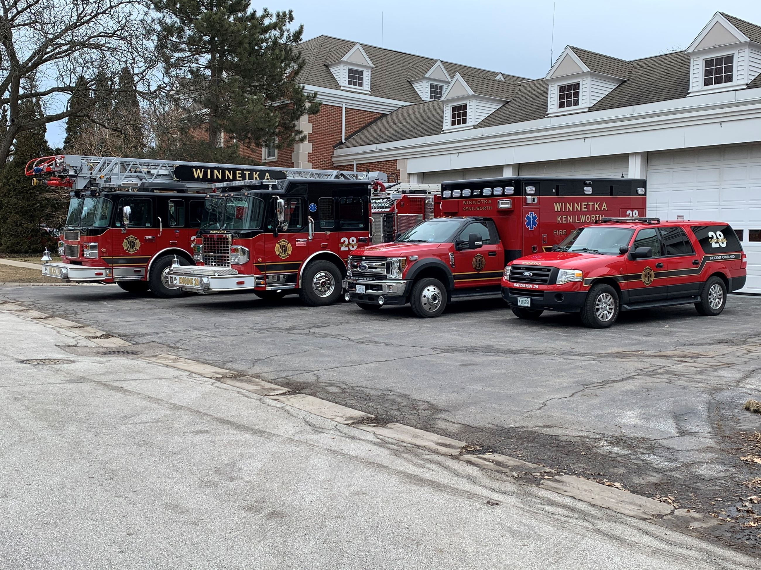 Fire Department Vehicles Parked Outside Station